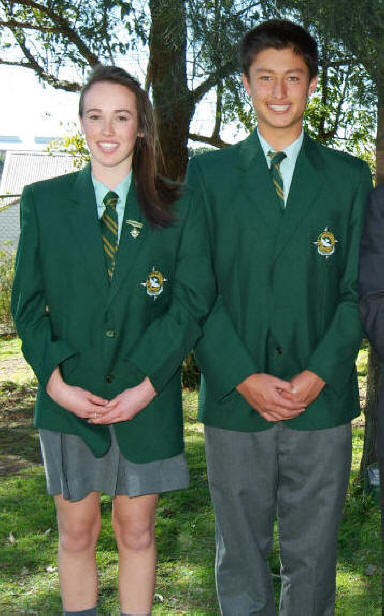 98b589974 Girls: Pale green shirt, green and yellow tie, grey skirt, grey socks or  stockings, green woollen jumper with school crest, blazer with school crest.